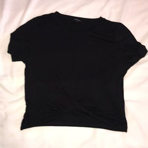 Black top, short sleeve,crossed over at the bottom